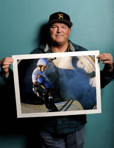 Photographer J. Grant Brittain holds one of his  photographs of local skateboarder Chris Miller at the Action Sports Retail show at the San Diego Convention Center on Wednesday, Feb. 3, 2010. Brittain and Miller were signing to posters with the proceeds g